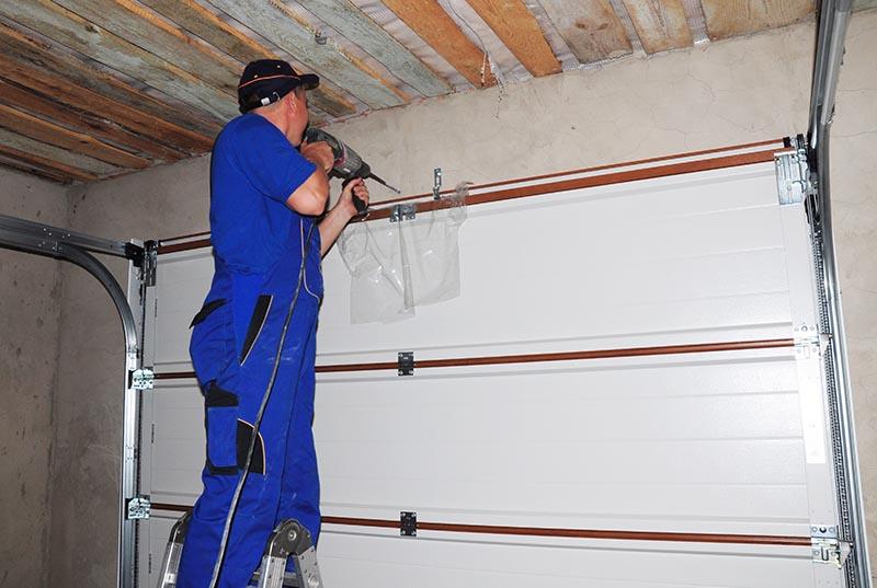 reparation porte garage sectionnelle et basculante